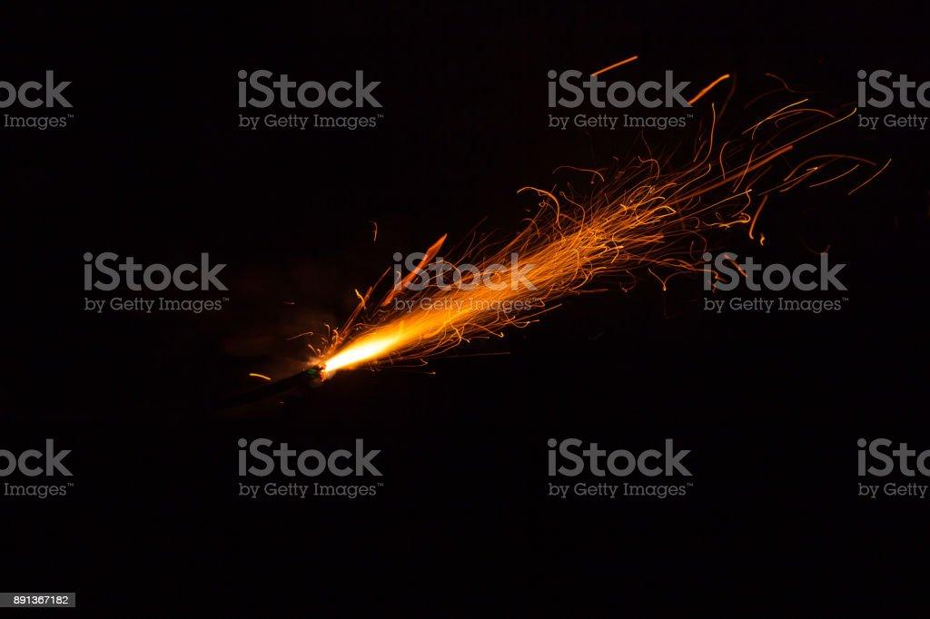 Burning fuse with sparks on black background stock photo