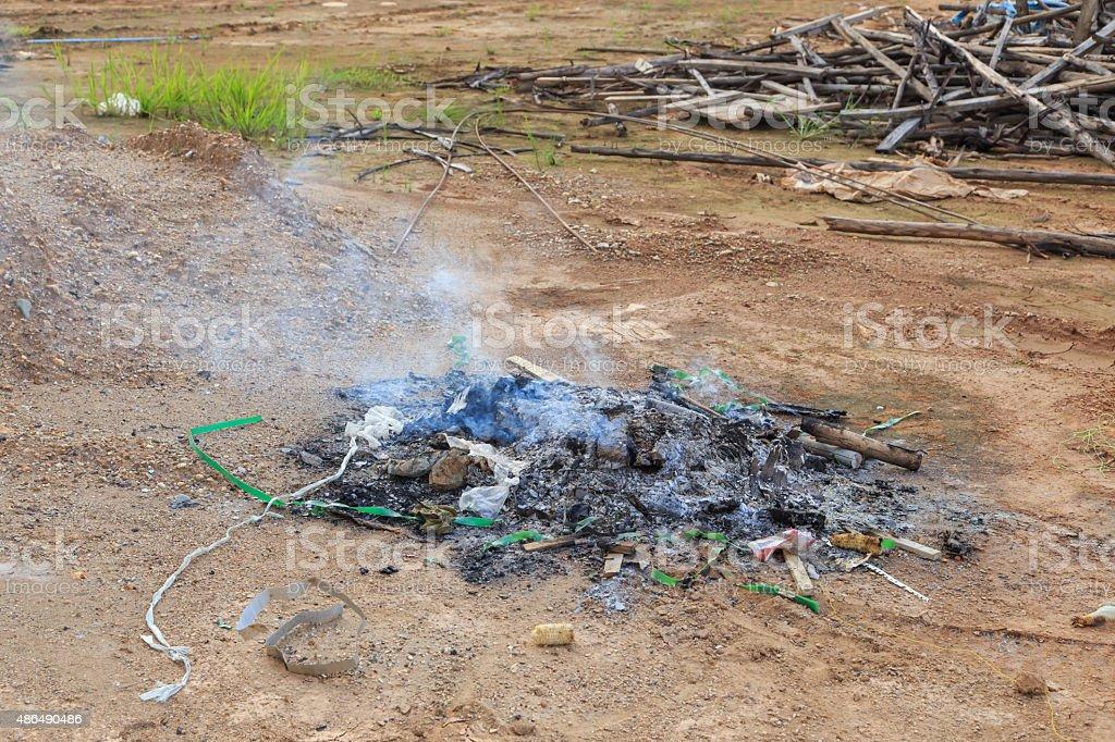 burning garbage with white smoke stock photo