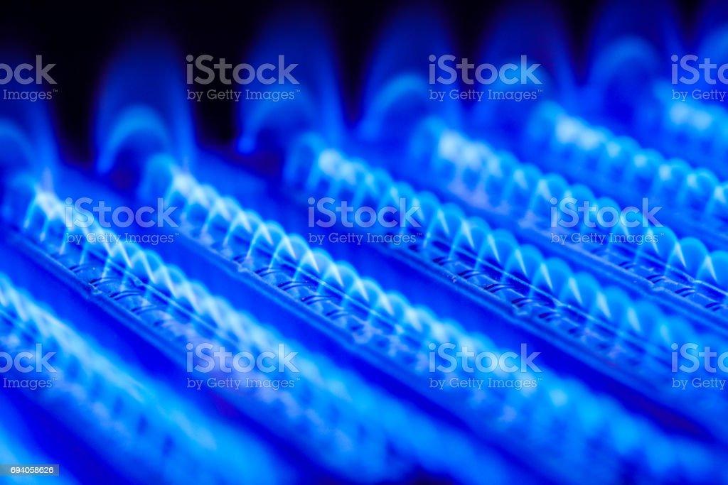 Burning gas in water heater furnace stock photo