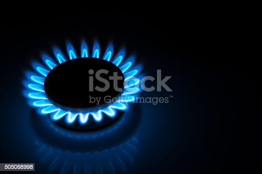 istock burning gas stove hob blue flames  in the dark 505068998