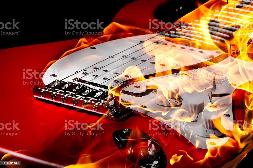 Burning guitar, closeup stock photo