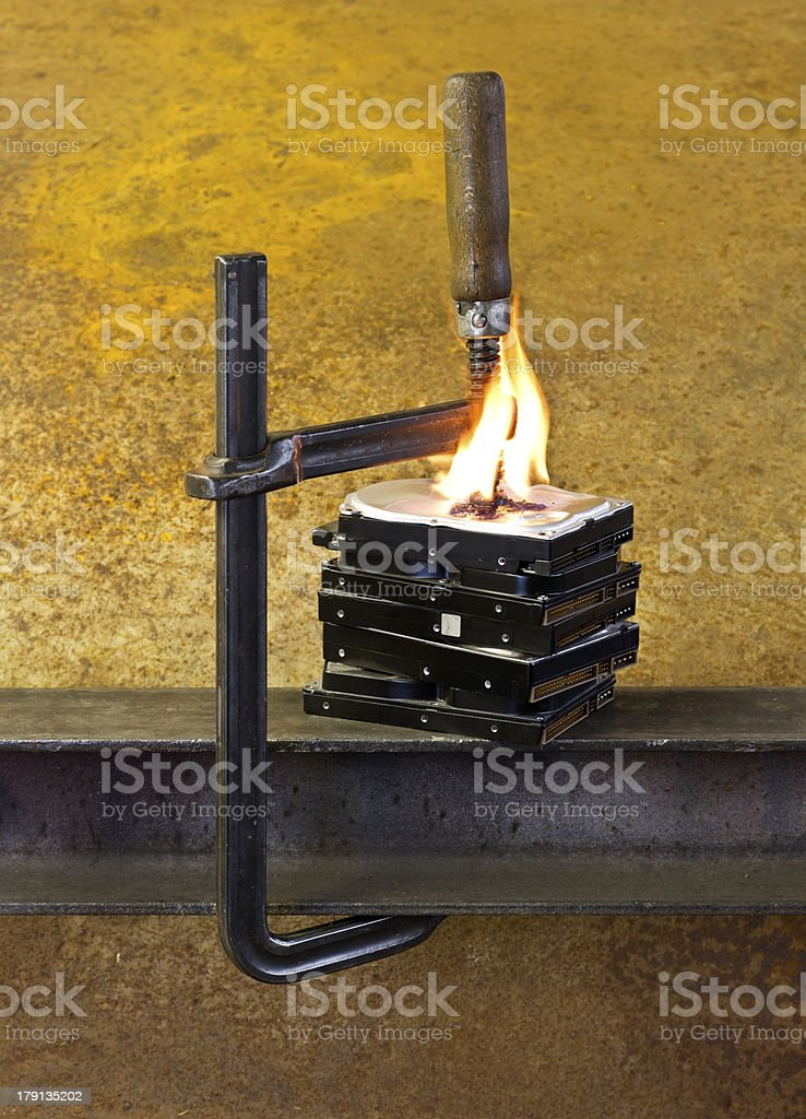 burning hard drives compressed with clamp royalty-free stock photo