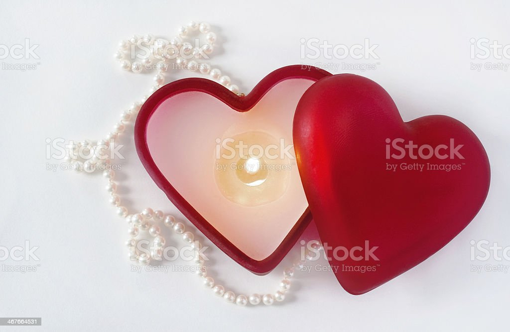 Burning Heart Candle with Pearls royalty-free stock photo