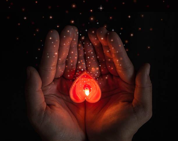 burning heart on hands. - hand tänder ett ljus bildbanksfoton och bilder