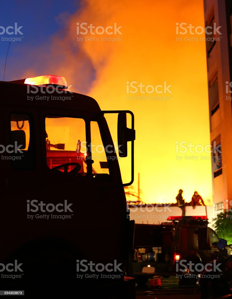 burning house, firefighters trying to extinguish the fire stock photo