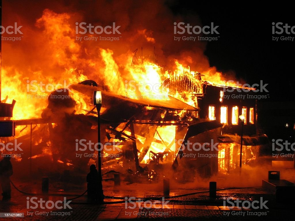 Burning house stock photo
