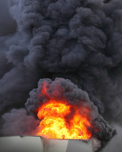 Burning house. Flames and black smoke - air pollution concept. fire natural phenomenon stock pictures, royalty-free photos & images
