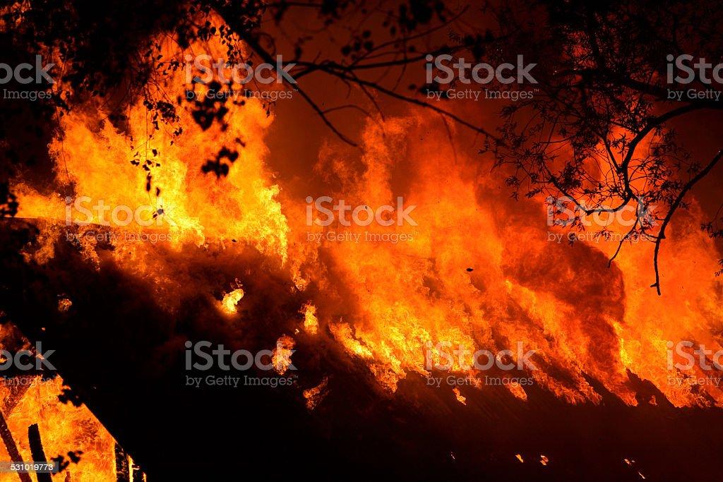 Burning in the night stock photo