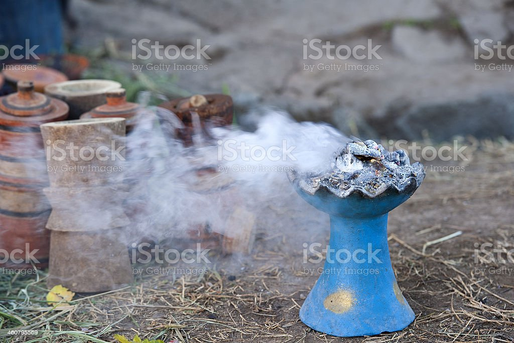 Burning incense as part of traditional Ethiopian coffee ceremony royalty-free stock photo