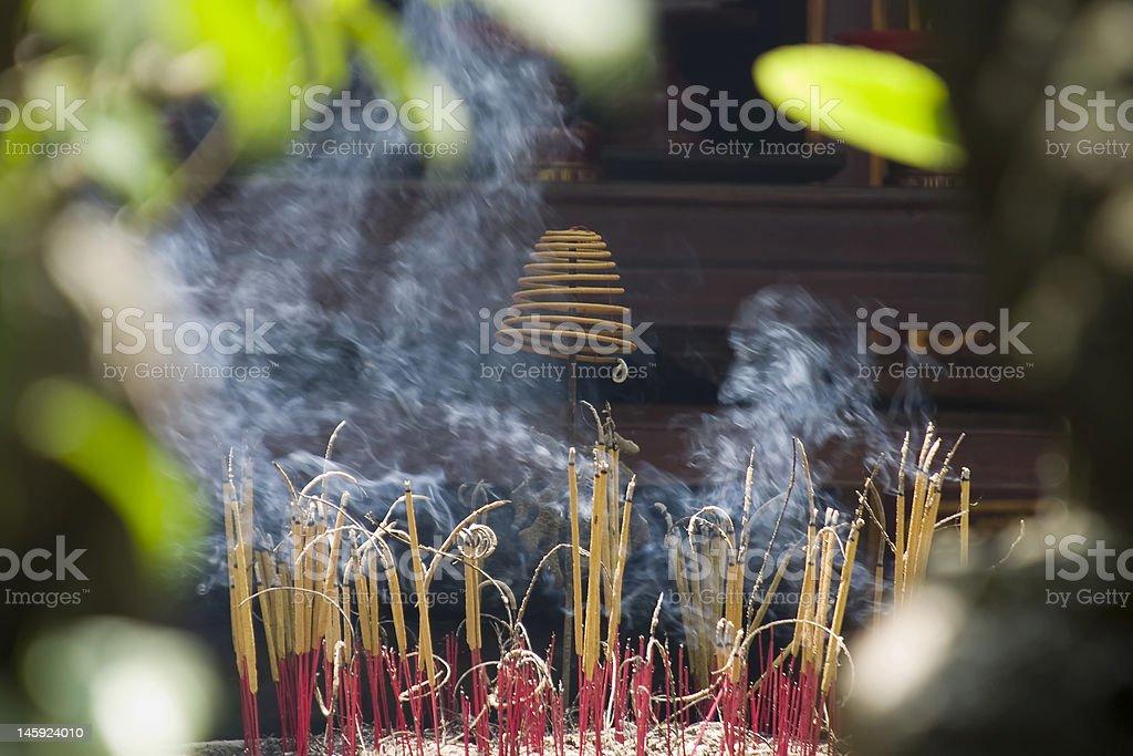 Burning incense at temple, Vietnam royalty-free stock photo