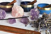 A close up image of burning incense and meditation crystals.
