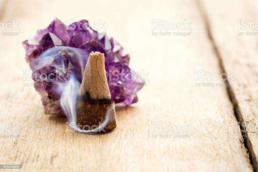 Burning Incense Cone With Amethyst Crystal With Wafting Smoke On