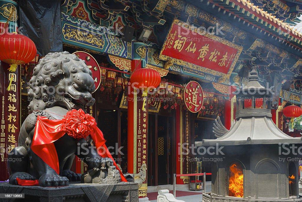Burning incense in Wong Tai Sin Temple in Hong Kong stock photo