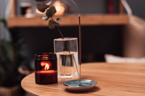 Burning Incense indoors in living room with candlelight Burning Incense indoors in living room with candlelight Close up of well fragrant incense incense stock pictures, royalty-free photos & images