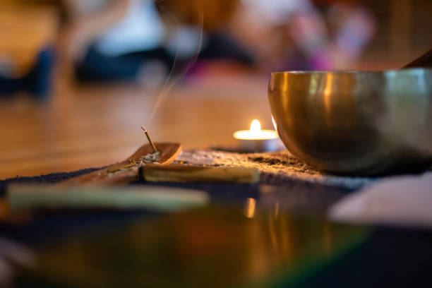 burning incense indoors in yoga class - meditation stock pictures, royalty-free photos & images