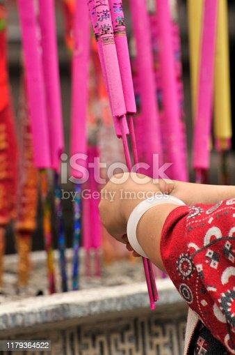 Woman lighting up incense sticks