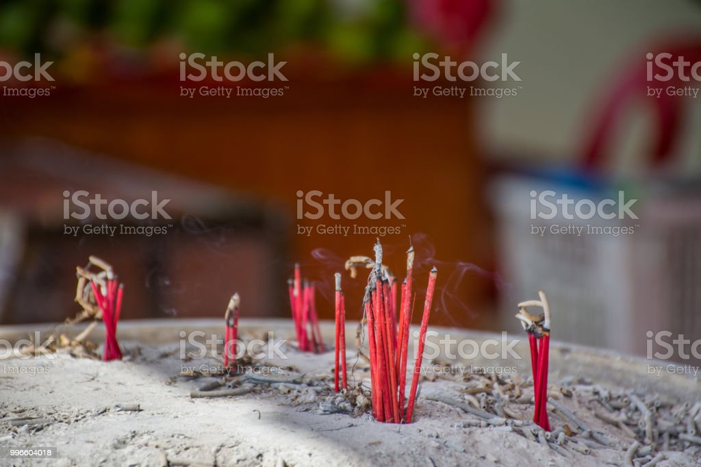 Burning Incense Sticks And Smoke In An Incense Pot Incense