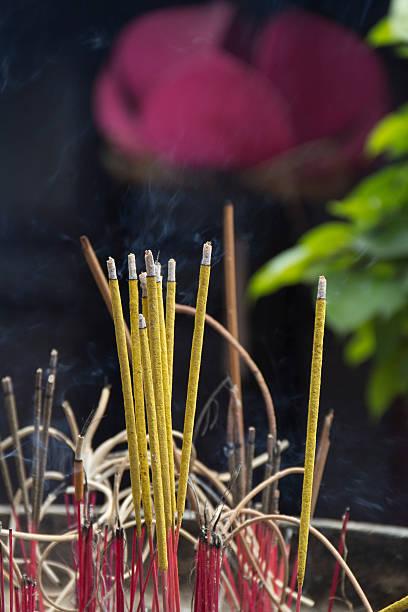 Burning Incense sticks, Tran Quoc Pagoda, Vietnam. stock photo