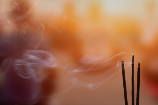 Burning Incense Sticks with smoke, joss sticks burning at a vintage Buddhist temple. Focus on incense stick and smoke. Burning Incense Sticks with smoke, joss sticks burning at a vintage Buddhist temple. Focus on incense stick and smoke. incense stock pictures, royalty-free photos & images