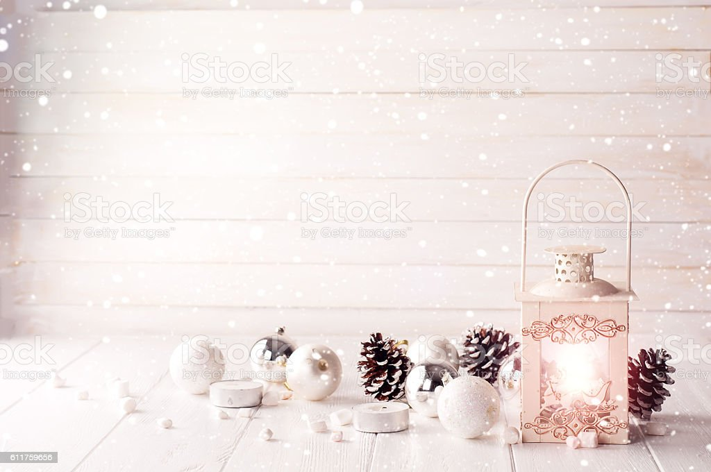 Burning lantern in the snow with christmas decoration stock photo