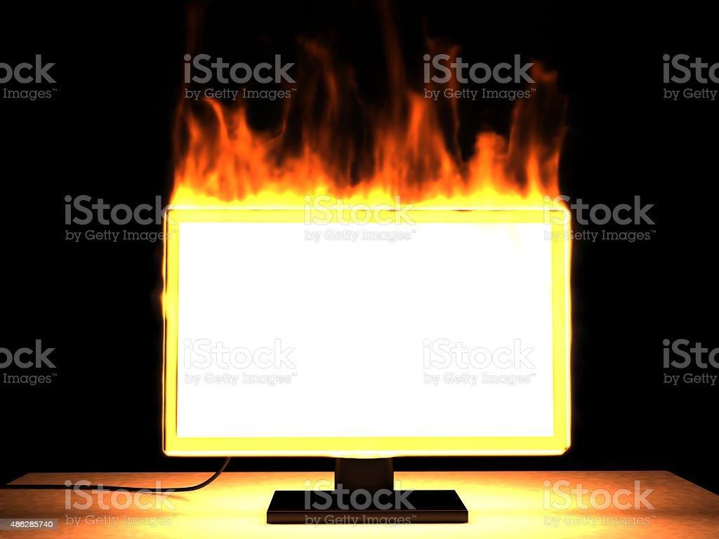 Burning LCD TV stock photo