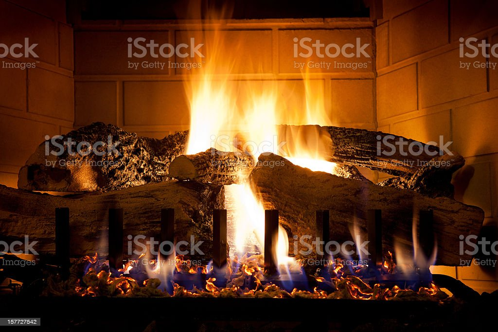 Burning Logs and Glowing Embers In Gas Fireplace stock photo