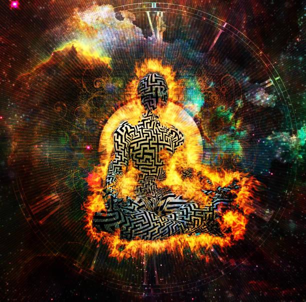 Burning man with maze pattern meditate in lotus pose stock photo