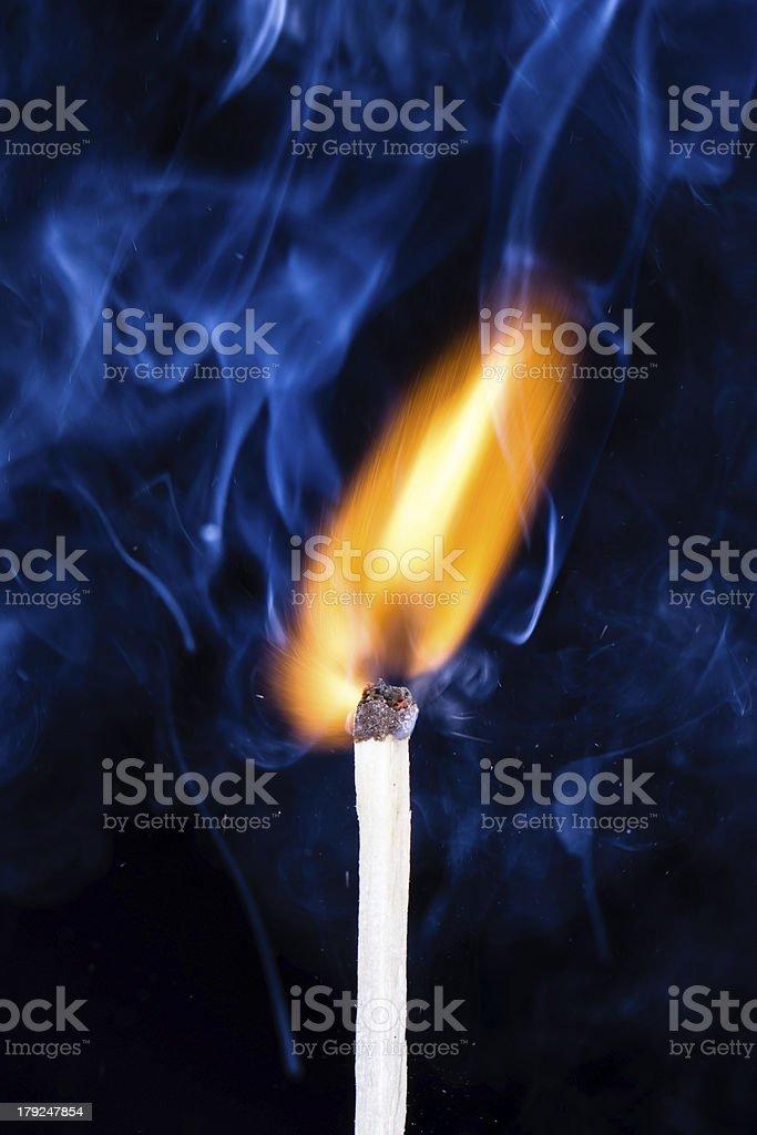 Burning Match and Smoke royalty-free stock photo