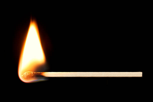 Burning Match Horizontal over Black stock photo