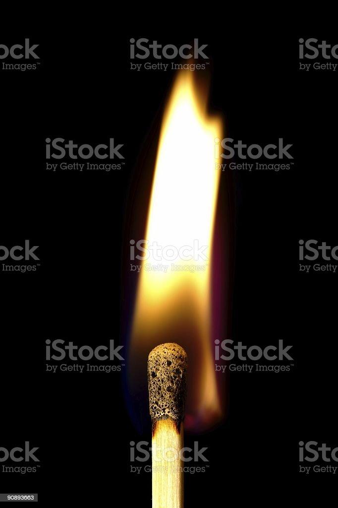 Burning match on a black background royalty-free stock photo