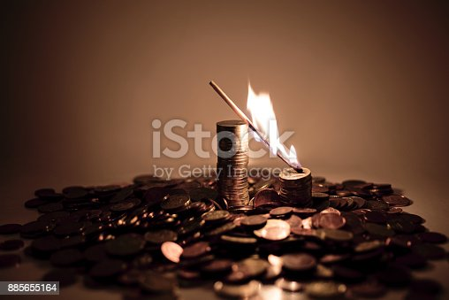 istock Burning match on euro coins. 885655164