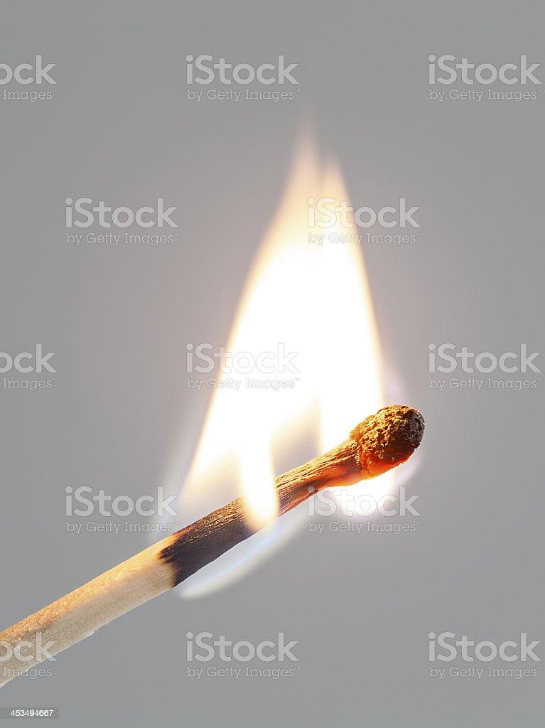 burning matchstick stock photo
