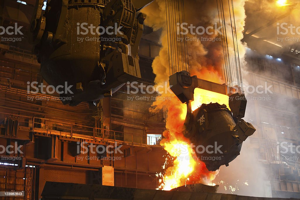 Burning metal inside a factory stock photo