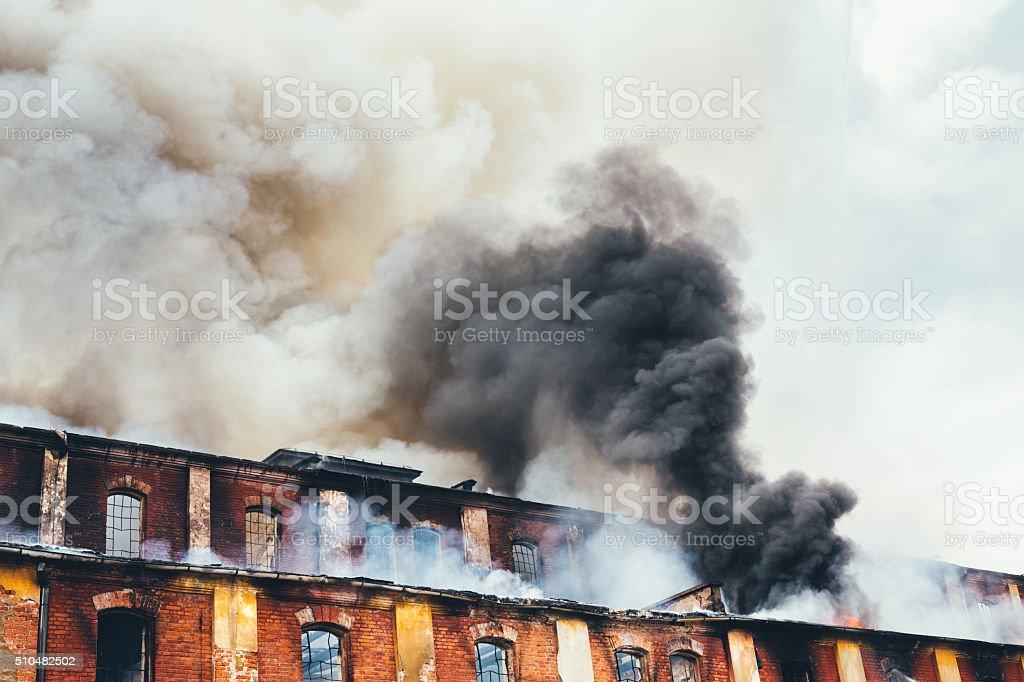 Burning Old Building stock photo