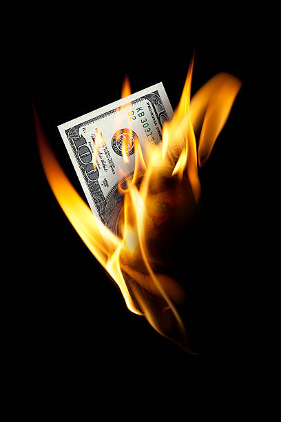 burning one hundred dollar - money black background stock photos and pictures