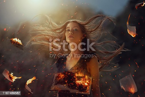 Witch in fire burning pages; background surrounded by burning pages