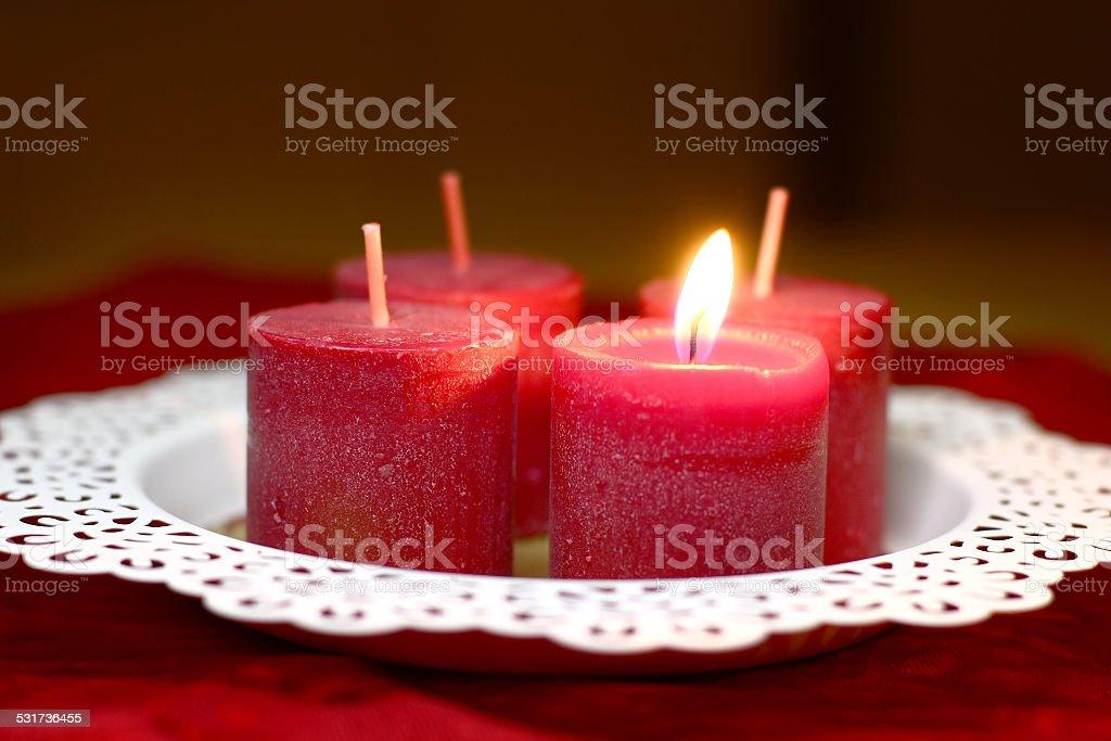 burning red candle on white tray stock photo