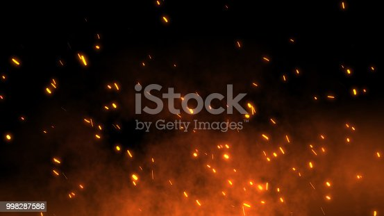 istock Burning red hot sparks fly away from large fire in the night sky 998287586