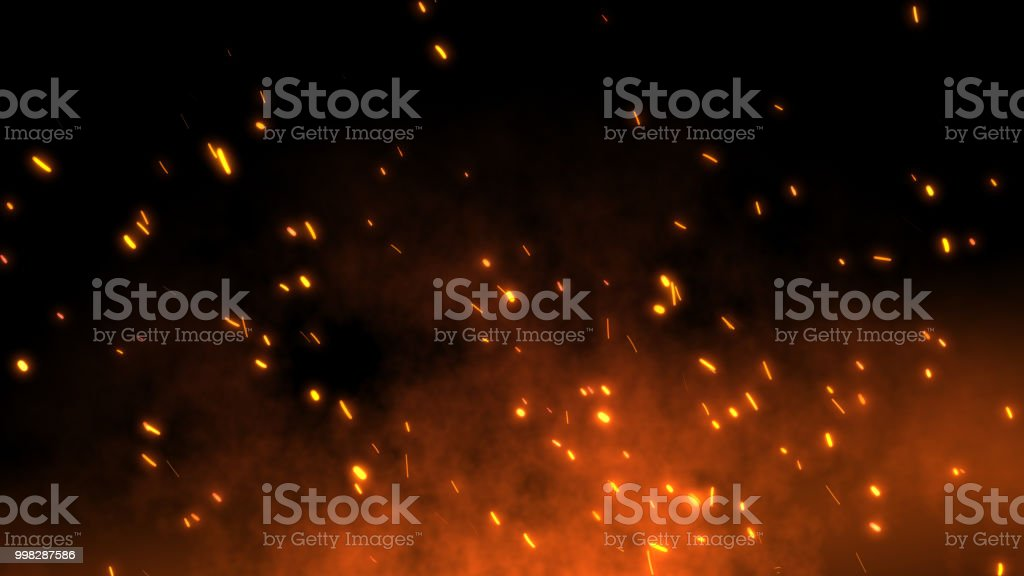 Burning red hot sparks fly away from large fire in the night sky stock photo