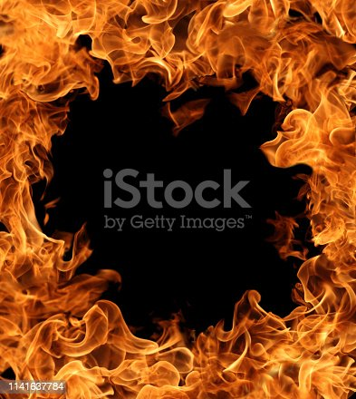 istock Burning ring of fire over dark background for abstract graphic design 1141637784