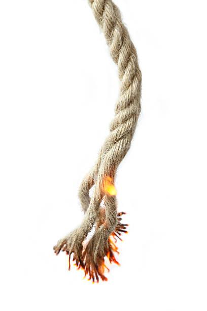 Burning ropes stock photo