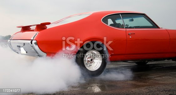 Oldmobile Cutlass Supreme getting ready to drag race.Other similar images....
