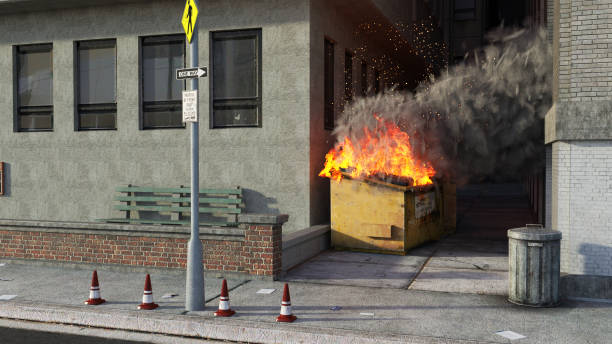 Burning rubbish bin in city Burning rubbish bin in city dumpster fire stock pictures, royalty-free photos & images