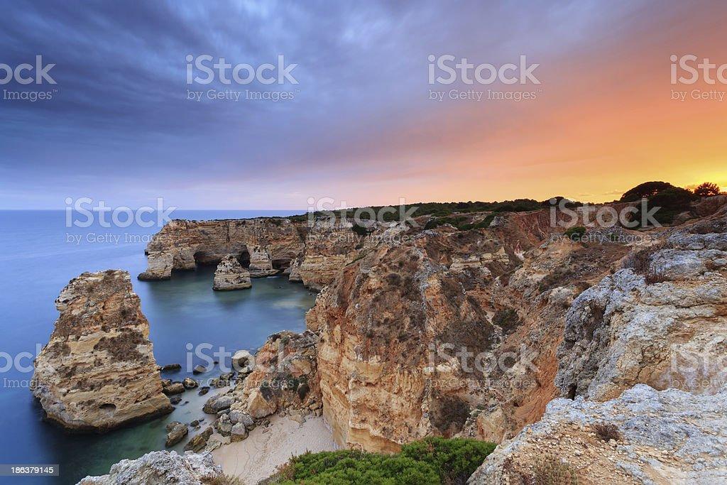 Burning sky on the Algarve Coast at sunset stock photo