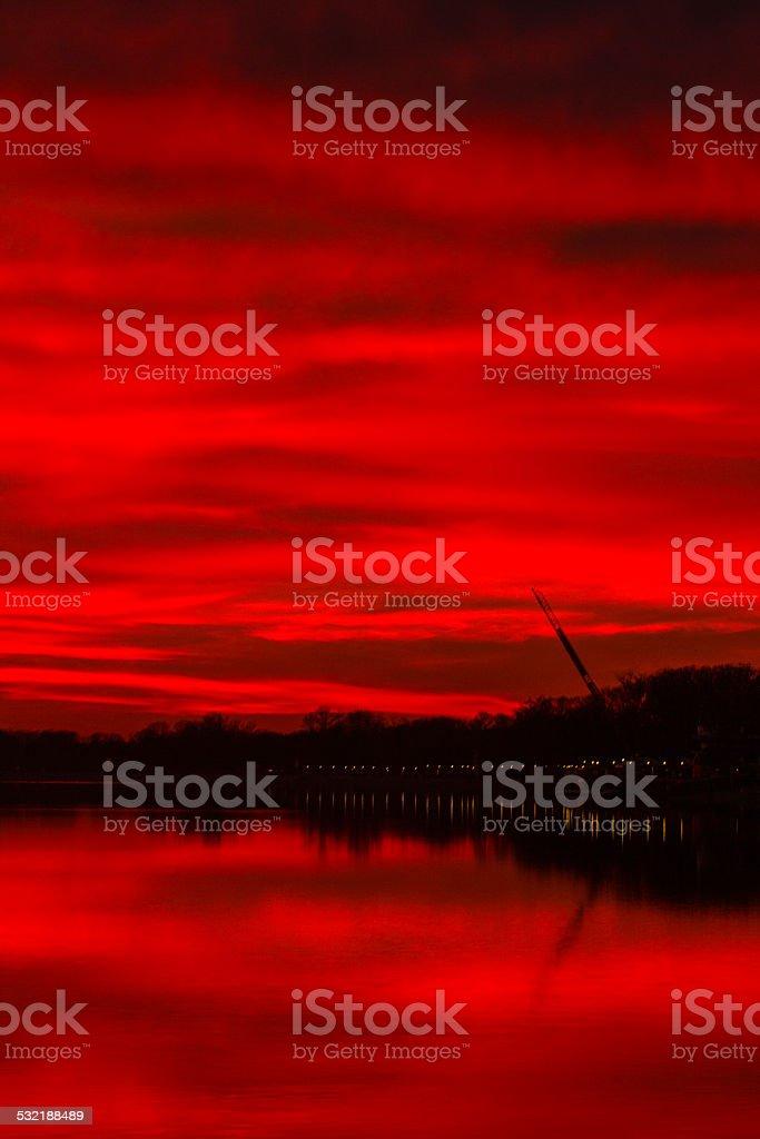 Burning sky - sunset over lake stock photo