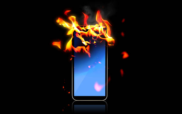 スマートフォンを燃やす - 炎上 ストックフォトと画像