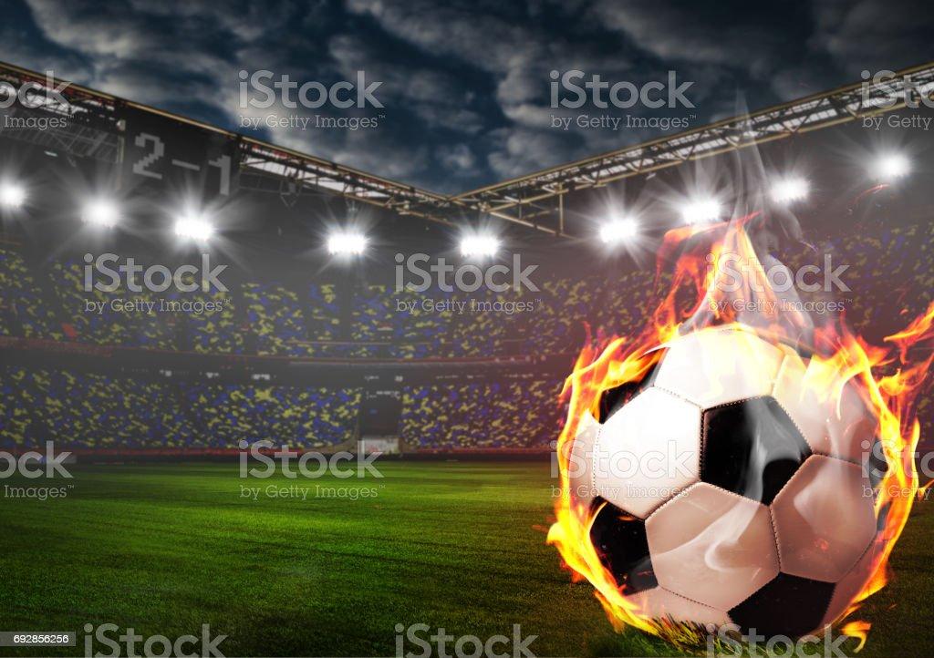 Burning soccer ball on stadium stock photo