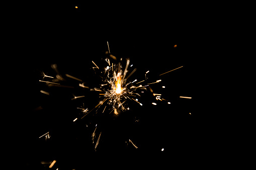 Burning sparkle in pitch black surrounding