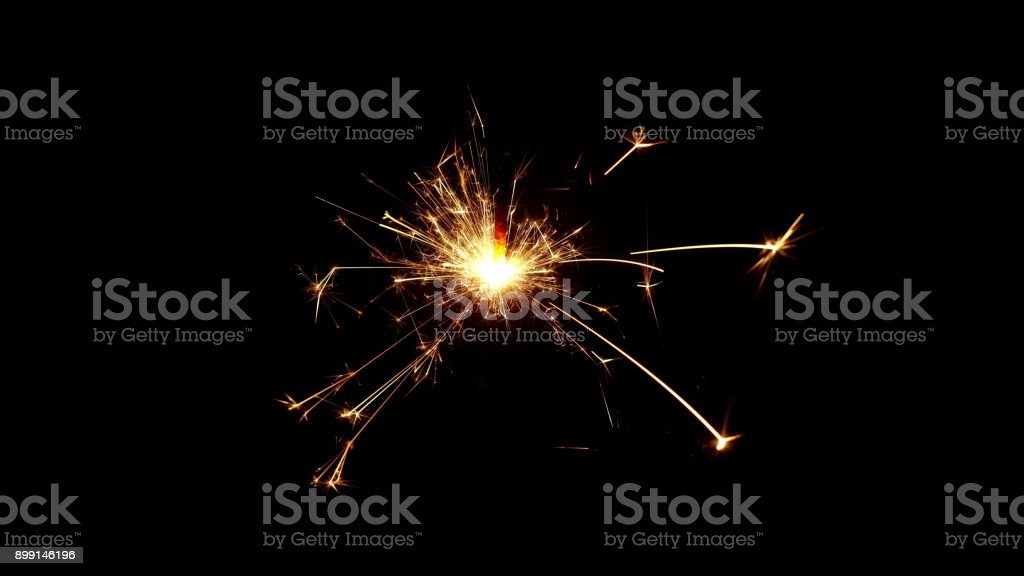 Burning sparkle in pitch black surrounding stock photo