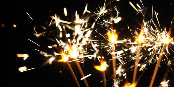 burning sparkler background, happy new year. panoramic view - new year стоковые фото и изображения